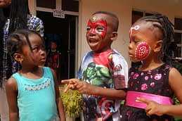 Excited children showed off their beautifully painted faces